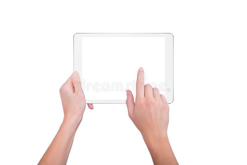 La muchacha sostiene una placa y golpea ligeramente la pantalla foto de archivo libre de regalías