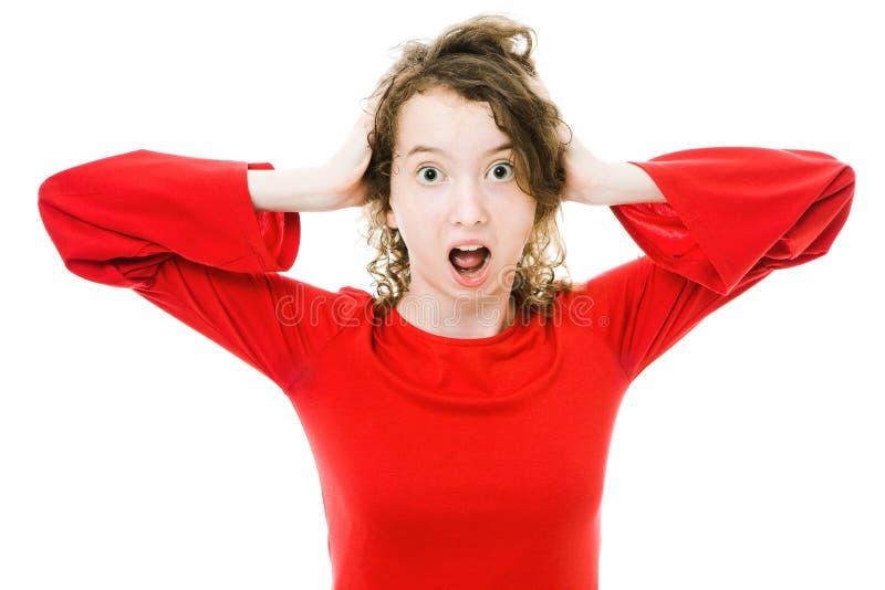 La muchacha Teenaged en vestido rojo sufre la tensión imagenes de archivo