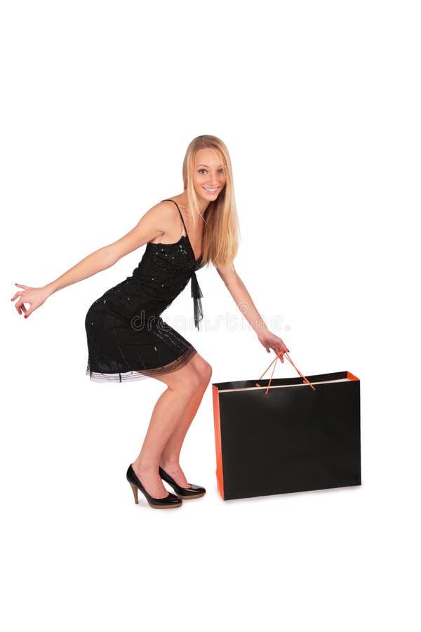 La muchacha toma el bolso del suelo fotografía de archivo