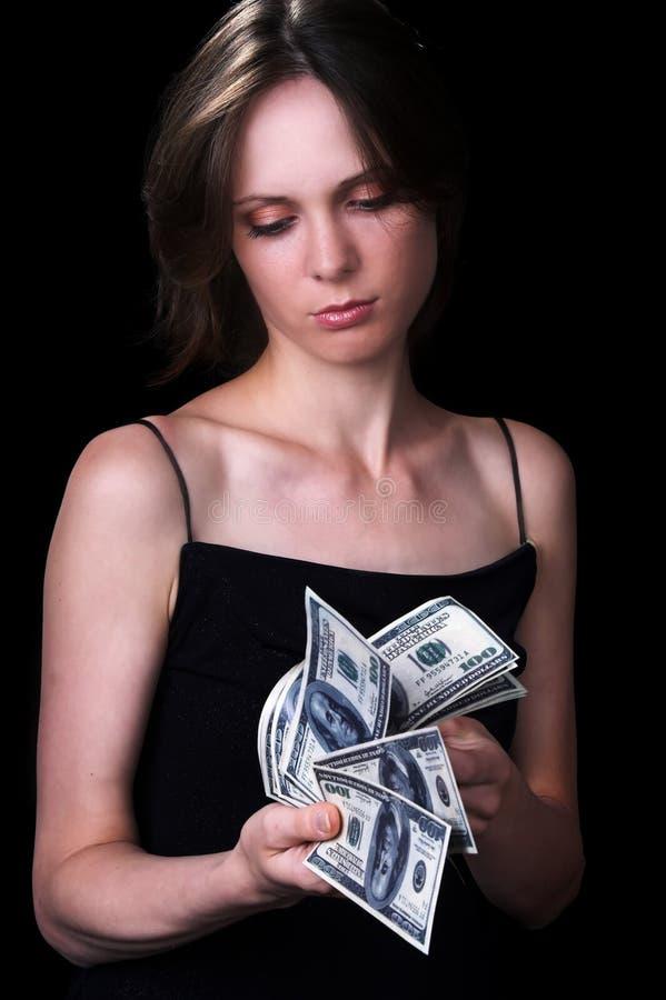 La muchacha y el dinero fotografía de archivo