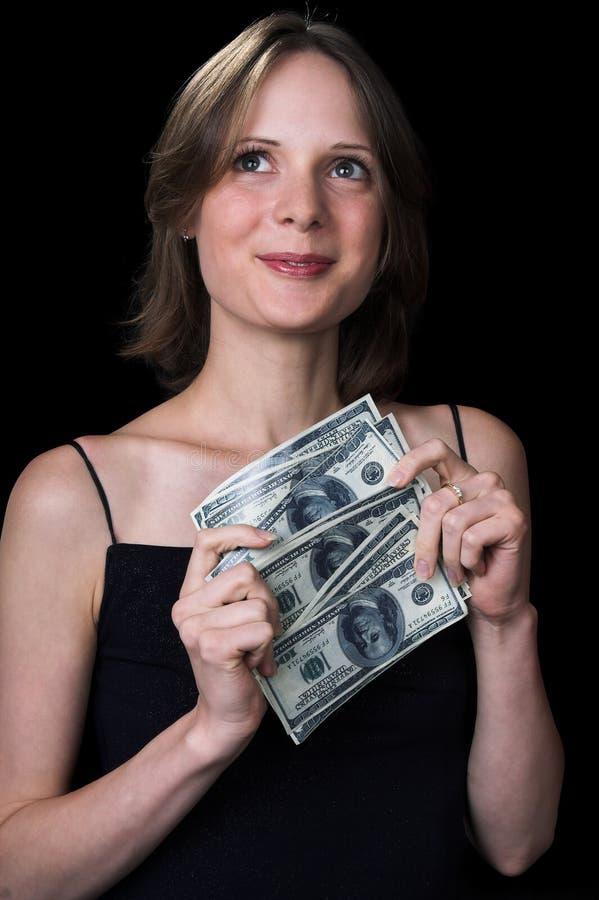 La muchacha y el dinero fotografía de archivo libre de regalías