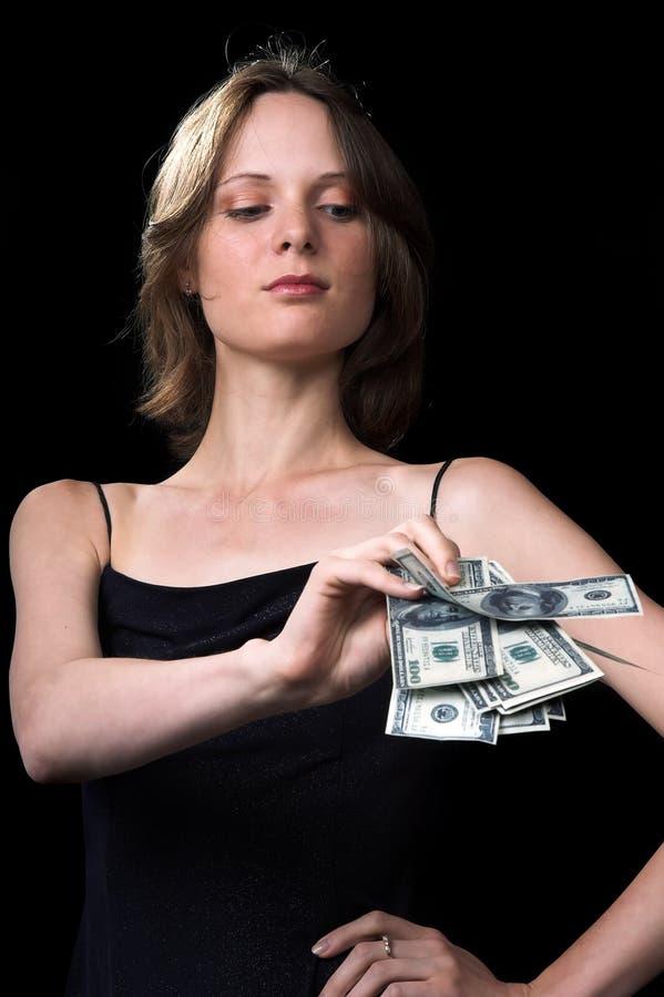 La muchacha y el dinero imagenes de archivo