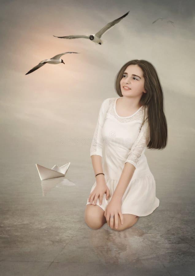 La muchacha y las gaviotas imagen de archivo libre de regalías