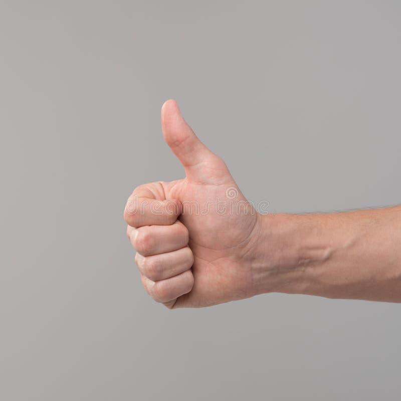 La muestra de la mano manosea con los dedos para arriba imagen de archivo libre de regalías