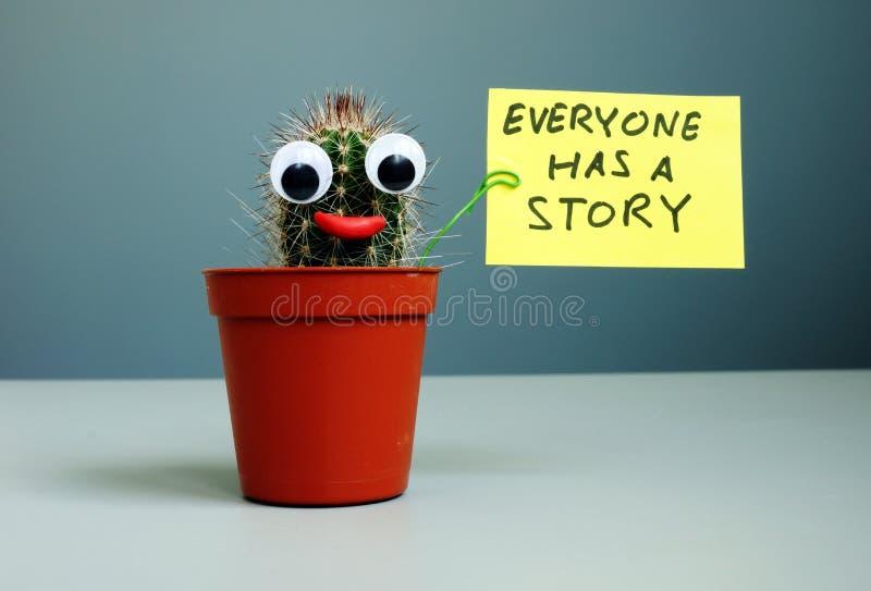 La muestra de la tenencia del cactus todo el mundo tiene una historia imagenes de archivo