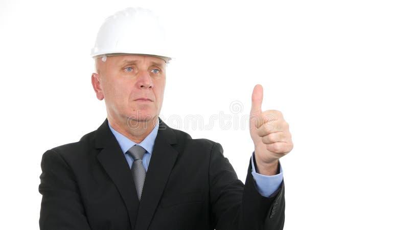 La muestra seria de la mano de Make Good Job del ingeniero manosea con los dedos para arriba fotografía de archivo
