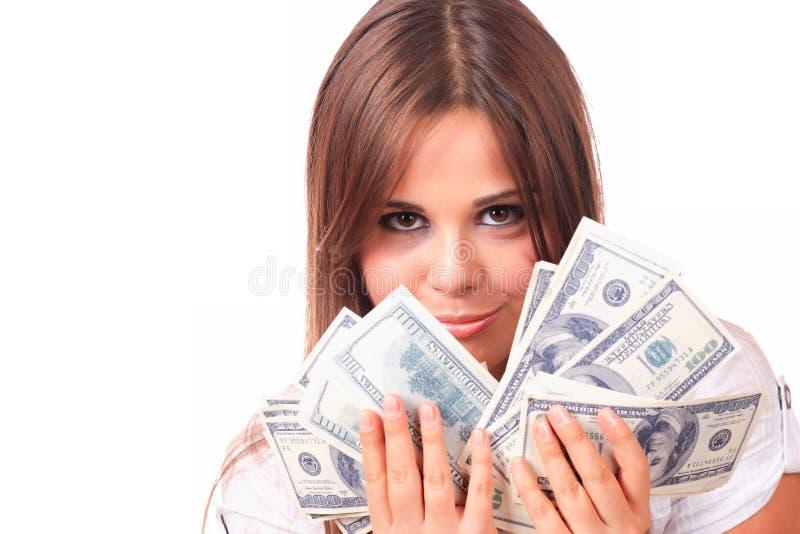 La mujer atractiva toma la porción de 100 cuentas de dólar imagenes de archivo