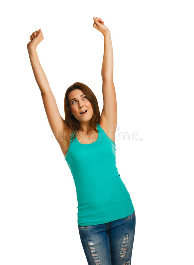 La mujer aumentó sus manos encima de la mirada feliz del éxito imagen de archivo libre de regalías