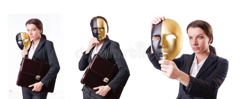 La mujer con la máscara en concepto de la hipocresía fotografía de archivo