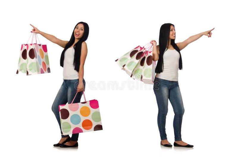 La mujer con los panieres aislados en blanco imagen de archivo libre de regalías