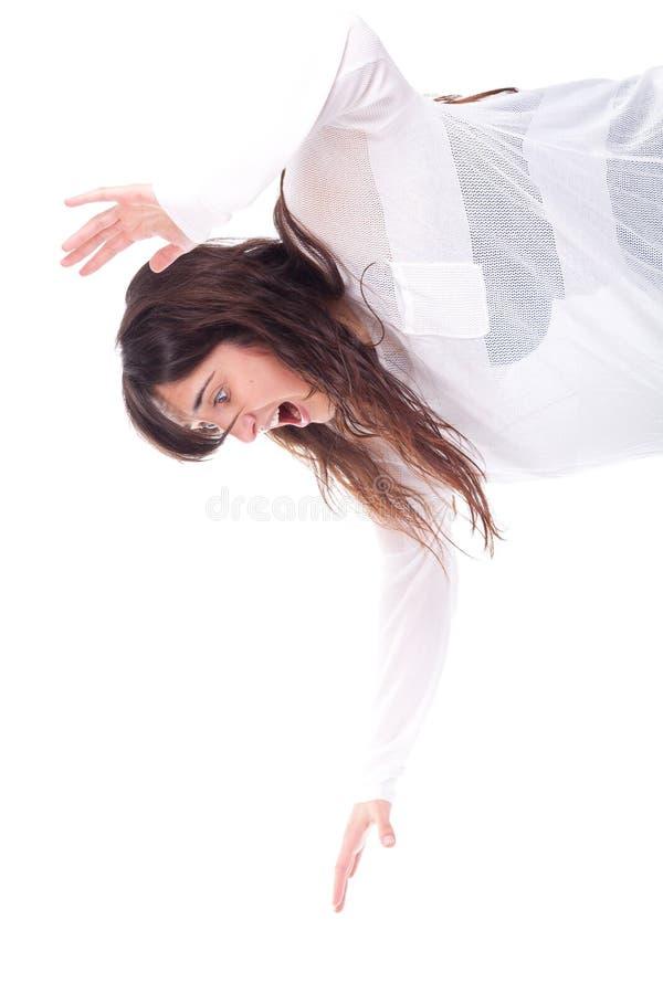 La mujer con sus brazos sube y gritando imagen de archivo