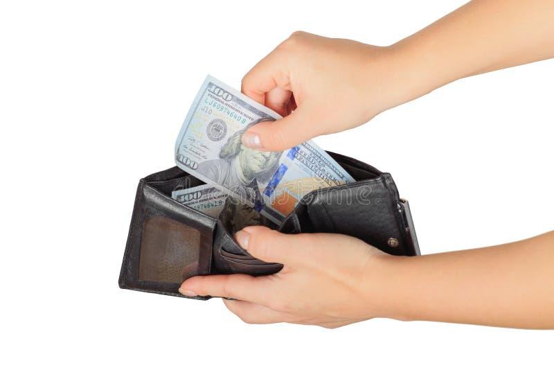 La mujer dólar saca o puso de su monedero de su monedero fotografía de archivo