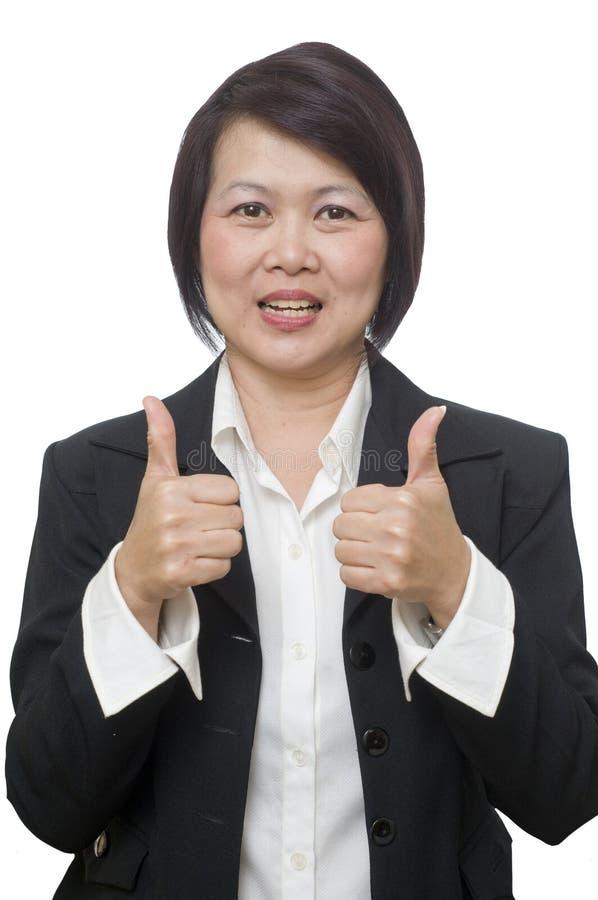 La mujer de negocios con los pulgares sube gesto foto de archivo libre de regalías