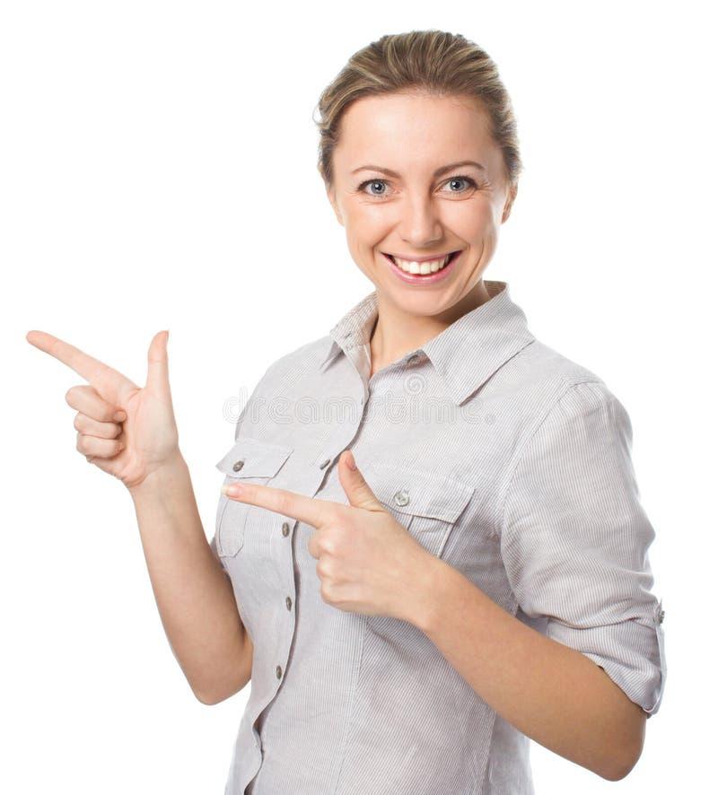 La mujer de negocios está señalando a un lado fotografía de archivo