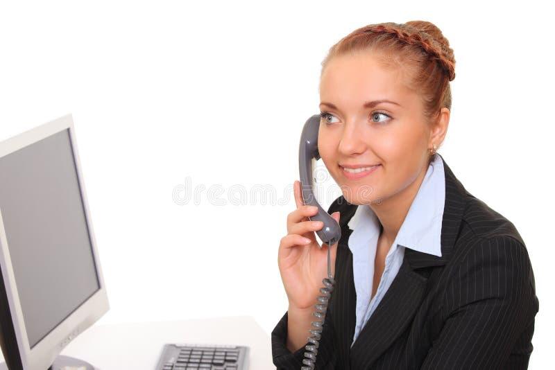 La mujer de negocios habla por el teléfono fotos de archivo libres de regalías