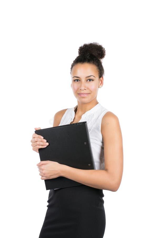 La mujer de negocios joven sostiene un fichero fotos de archivo libres de regalías