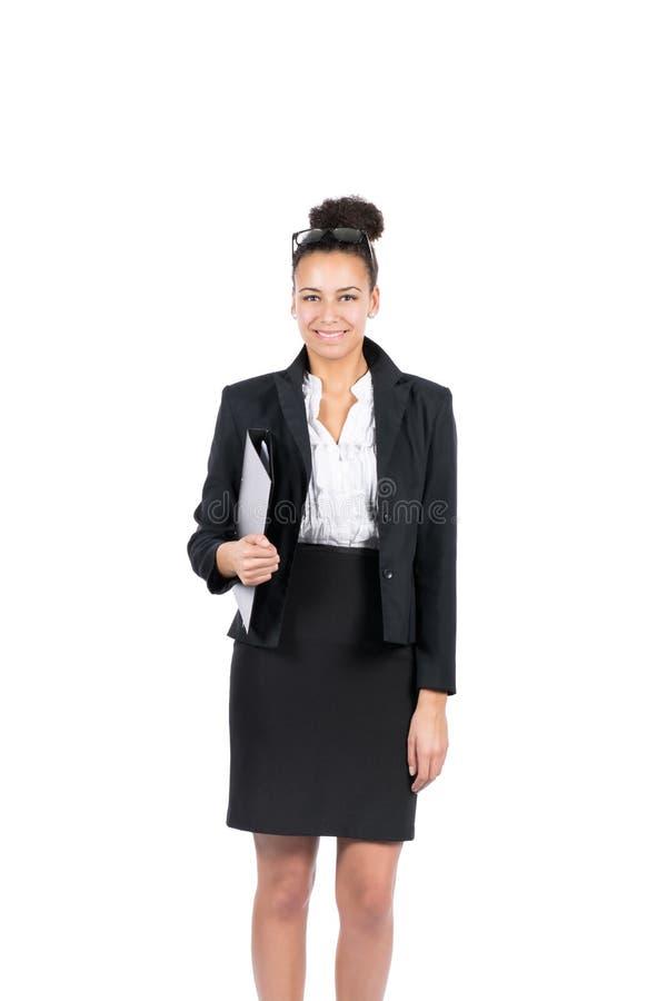 La mujer de negocios joven sostiene un fichero imagen de archivo libre de regalías