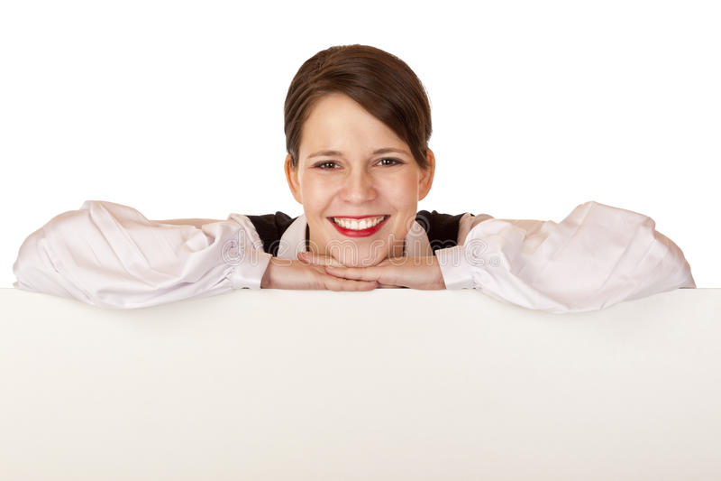 La mujer de negocios lleva a cabo la tarjeta de anuncio en blanco imagen de archivo libre de regalías