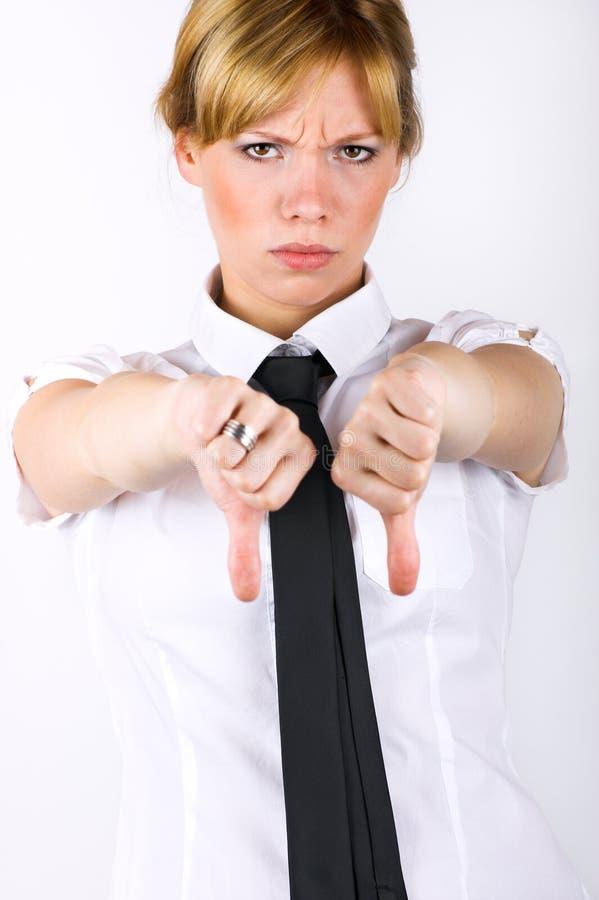 La mujer de negocios manosea con los dedos abajo fotografía de archivo libre de regalías
