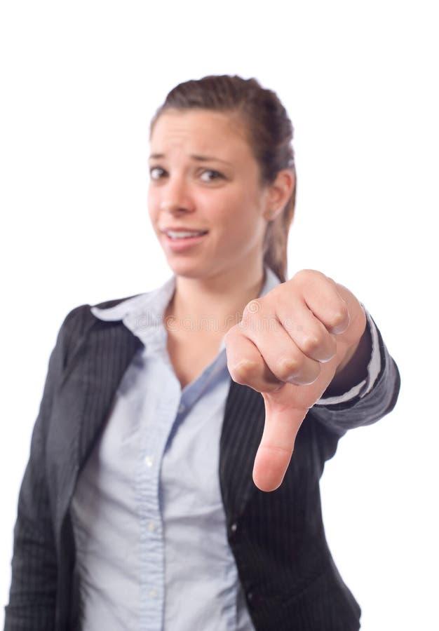 La mujer de negocios manosea con los dedos abajo foto de archivo