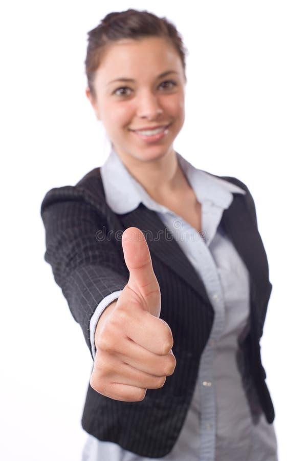 La mujer de negocios manosea con los dedos para arriba fotos de archivo libres de regalías
