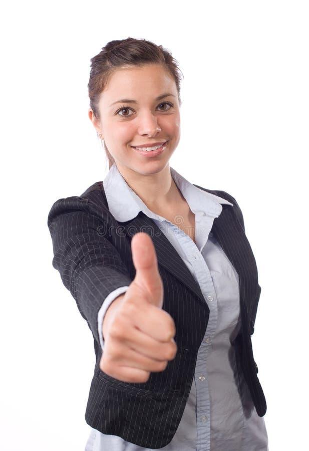 La mujer de negocios manosea con los dedos para arriba foto de archivo