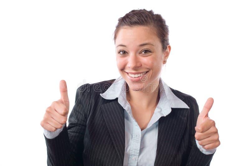 La mujer de negocios manosea con los dedos para arriba imagenes de archivo