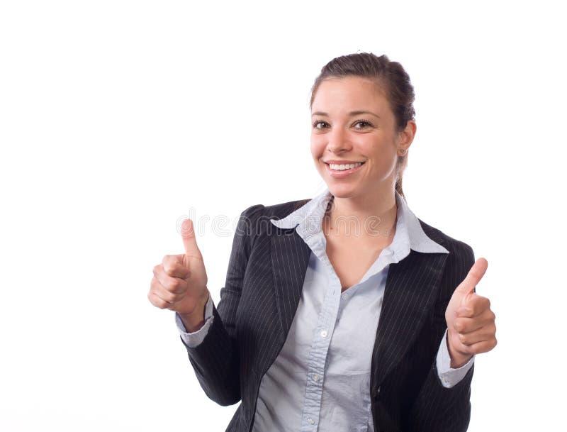 La mujer de negocios manosea con los dedos para arriba fotografía de archivo libre de regalías