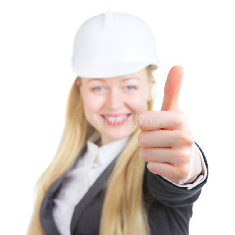 La mujer del ingeniero manosea con los dedos para arriba fotos de archivo libres de regalías