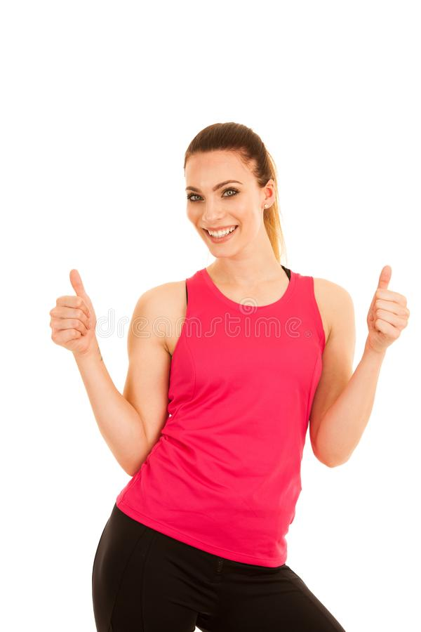 La mujer deportiva joven de Beautifil muestra el pulgar para arriba como succ de las FO del gesto imagen de archivo libre de regalías