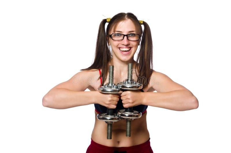 La mujer divertida con pesas de gimnasia aislada en blanco foto de archivo libre de regalías