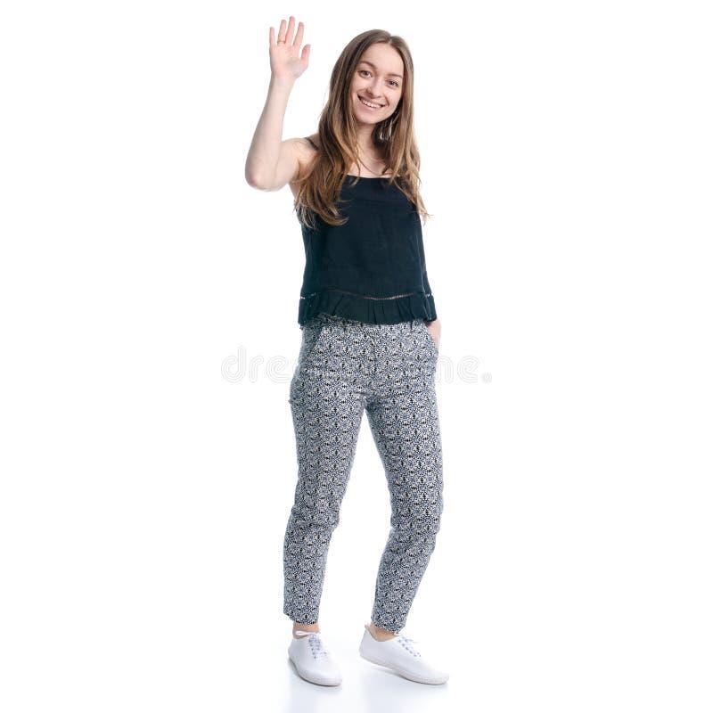 La mujer en caminar negro de la camiseta y de los pantalones va a agitar la mano imágenes de archivo libres de regalías