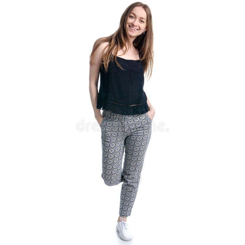 La mujer en caminar negro de la camiseta y de los pantalones va imagen de archivo libre de regalías