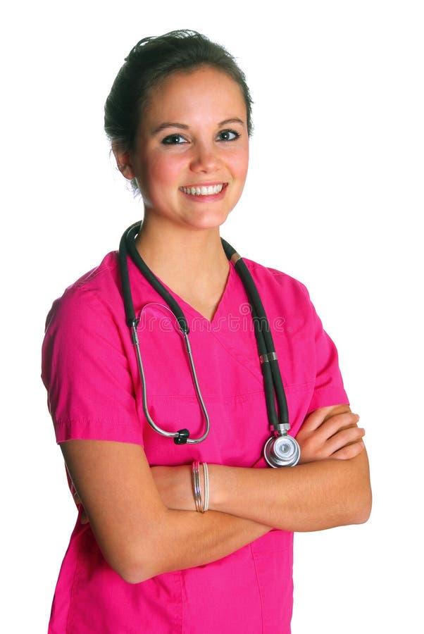 La mujer en color de rosa friega imagenes de archivo