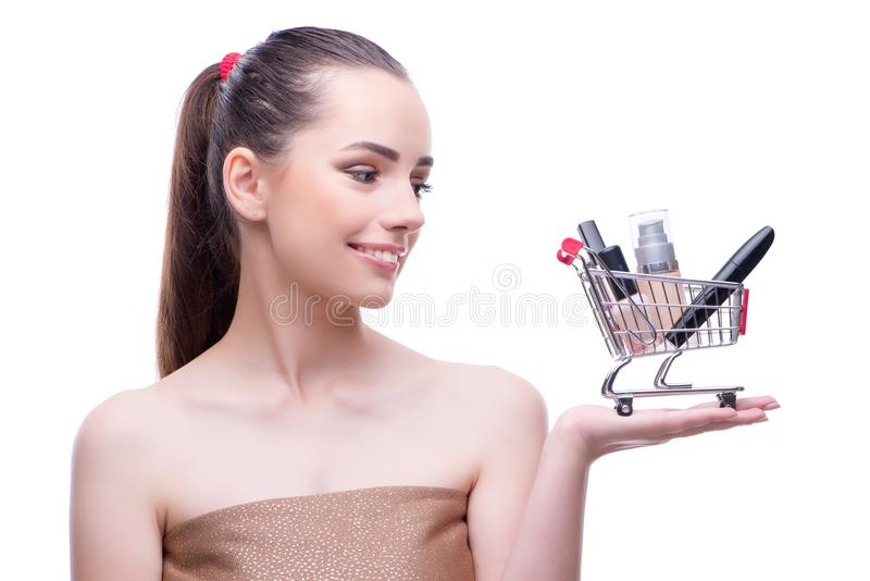 La mujer en concepto de la belleza con compone sostener el carro de la compra imagen de archivo libre de regalías
