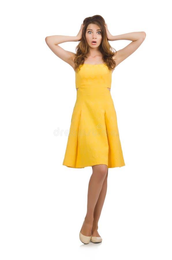 La mujer en el vestido amarillo aislado en blanco imagen de archivo libre de regalías