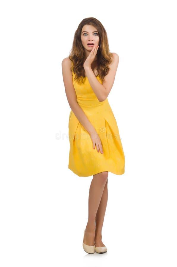 La mujer en el vestido amarillo aislado en blanco fotos de archivo