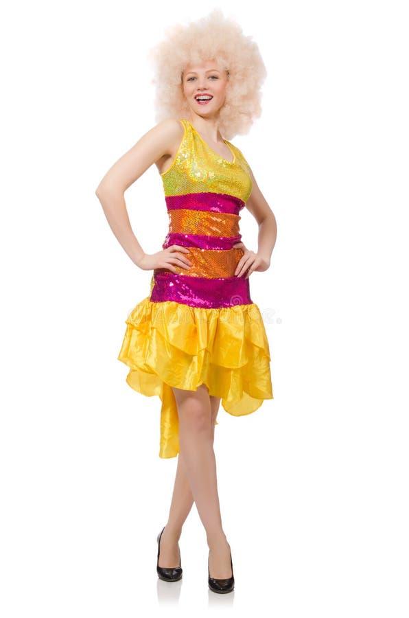 La mujer en el vestido amarillo chispeante divertido aislado en blanco fotografía de archivo libre de regalías