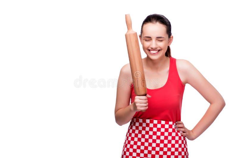 La mujer enojada joven con el rodillo aislado en blanco fotografía de archivo