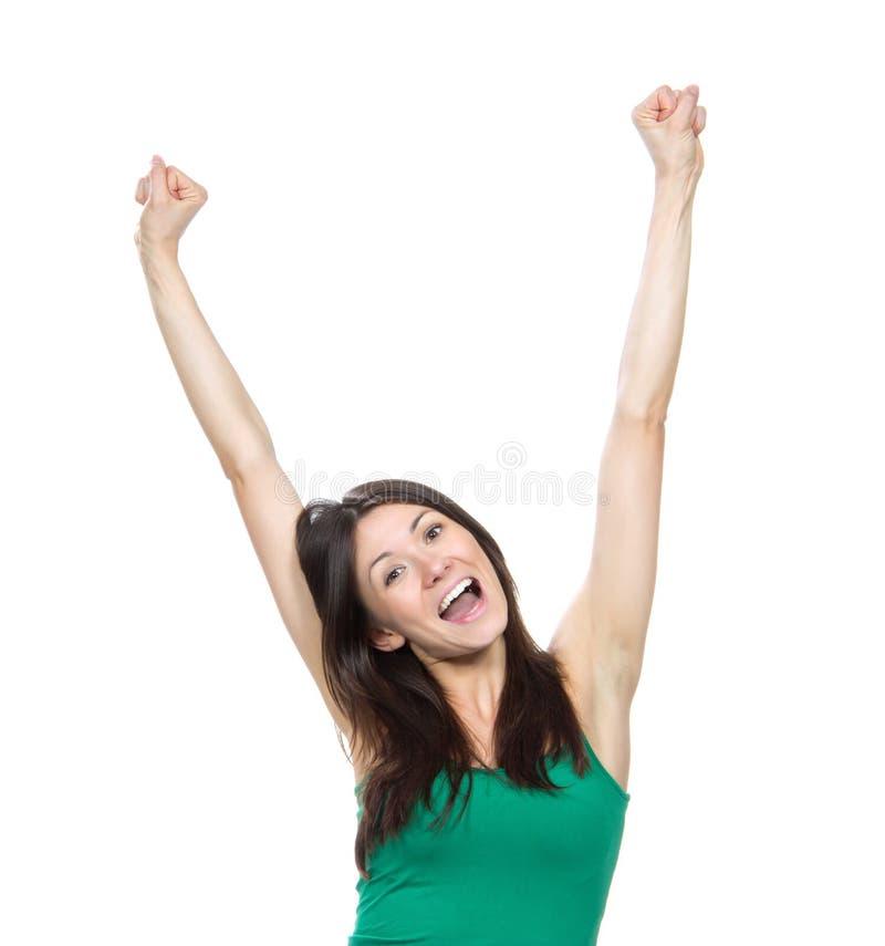 La mujer feliz con los brazos aumentados o las manos sube la muestra fotos de archivo