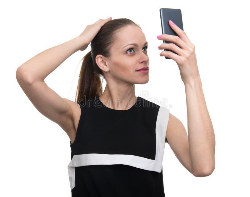 La mujer hace un selfie fotografía de archivo