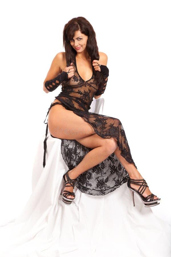 La mujer hermosa desgasta la ropa atractiva. fotos de archivo libres de regalías