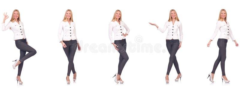 La mujer hermosa en los pantalones aislados en blanco fotografía de archivo