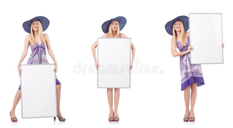 La mujer hermosa en vestido p?rpura con whiteboard imagen de archivo