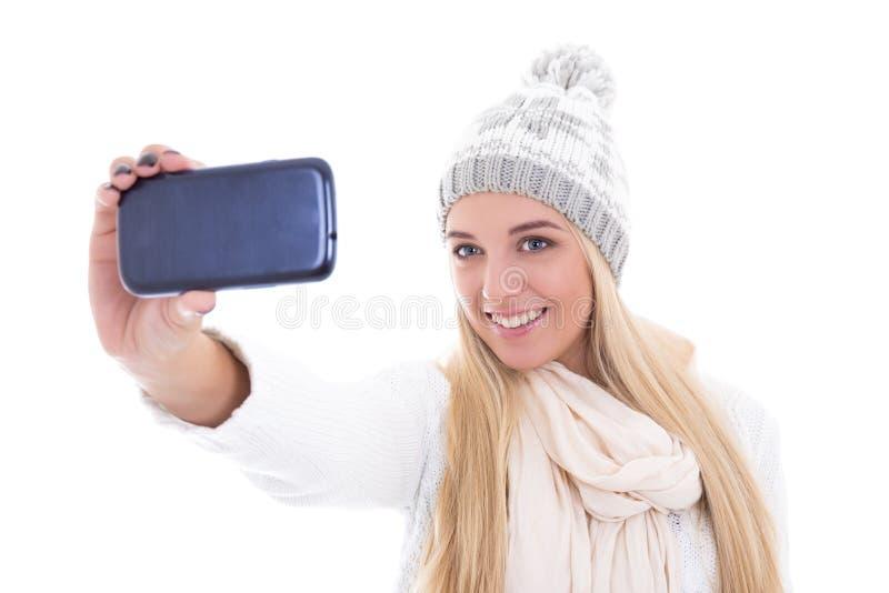 La mujer hermosa linda en invierno viste tomar isola de la foto del selfie fotos de archivo