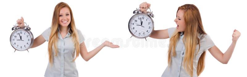 La mujer joven con el reloj en blanco fotos de archivo