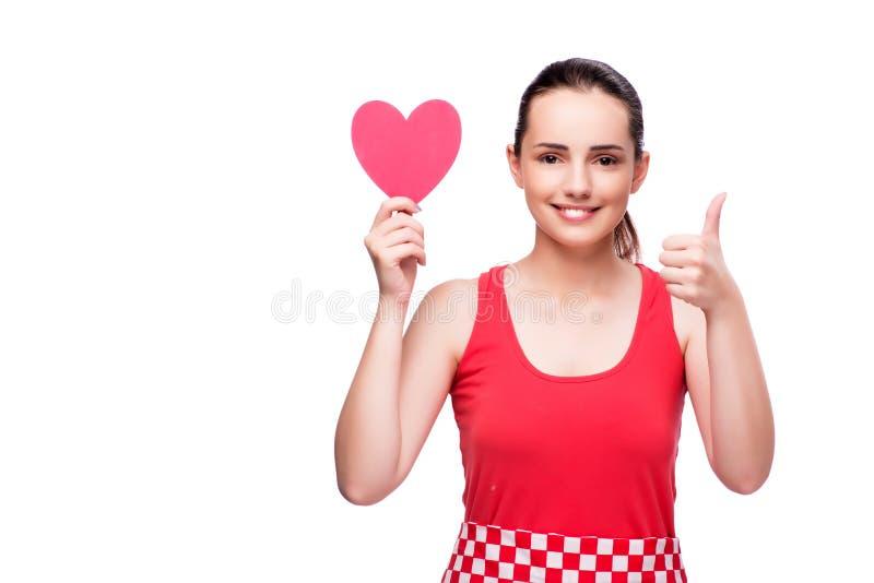 La mujer joven con en forma de corazón aislada en blanco foto de archivo libre de regalías