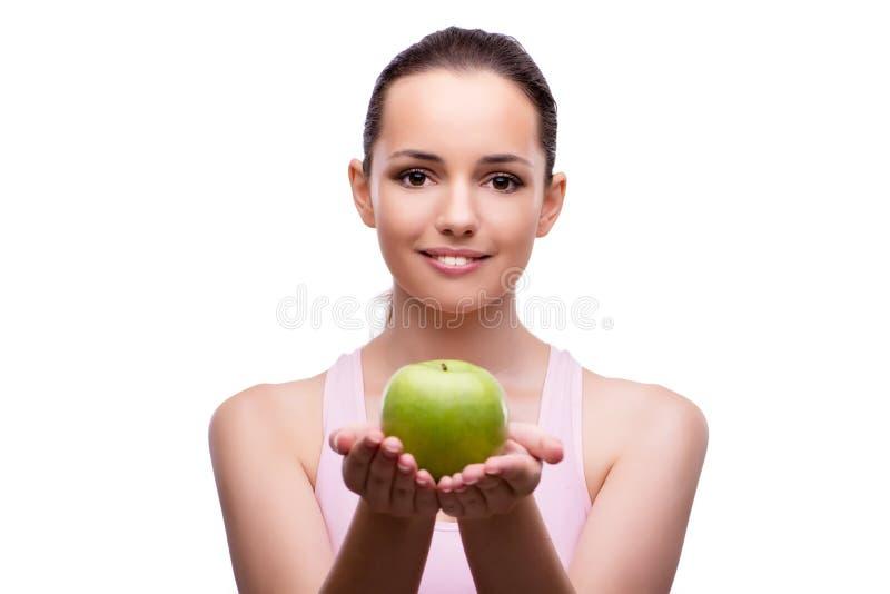 La mujer joven con la manzana verde aislada en blanco fotografía de archivo libre de regalías
