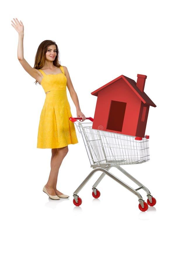 La mujer joven en concepto de vivienda de la hipoteca imágenes de archivo libres de regalías