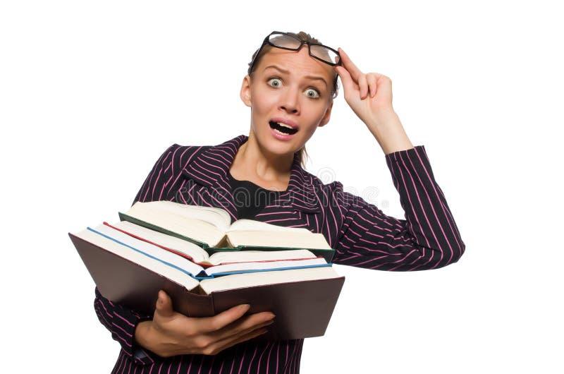 La mujer joven en el traje p?rpura que sostiene los libros fotografía de archivo